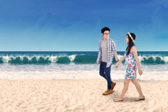 Two couple holding hands at seashore Royalty Free Stock Images