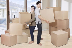 Two couple lifting cardboards at home Stock Photo