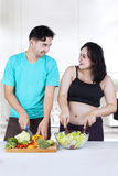 Two couple making salad Royalty Free Stock Photo