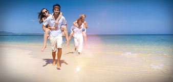 Two Couple Relaxing Beach Carrying Summer Leisure Concept Stock Images