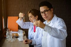 Two scientist test chemical liquid in lab Stock Image