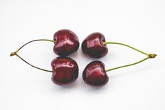 Two couple sweet cherries, isolated, toned Royalty Free Stock Image