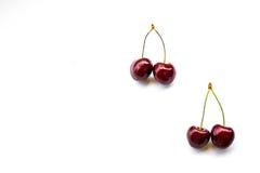 Two couple sweet cherries Stock Image