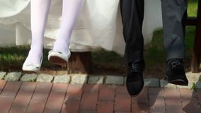 Two couple, wife and husband and their legs.  stock footage