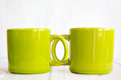 Two coupled coffee mugs Stock Photography
