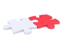 Two coupled puzzle peaces Royalty Free Stock Photos