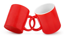 Two coupled red mugs Stock Photos