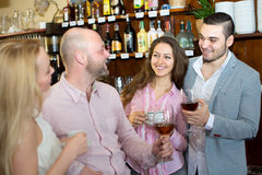 Two couples in a bar Royalty Free Stock Photos