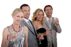 Two couples celebrating Stock Image