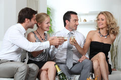 Two couples celebrating Stock Photography