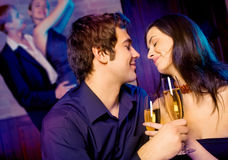Two couples celebrating together stock photography