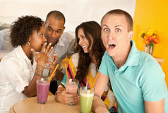 Two Couples Dining Out. Two couples at a cafe drinking frozen beverages. Horizontal shot Royalty Free Stock Photo