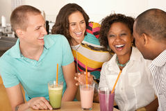 Two Couples Dining Out. Two couples at a cafe drinking frozen beverages. Horizontal shot Stock Photography