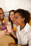 Two Couples Dining Out. Two couples at a cafe drinking frozen beverages. Vertical shot Royalty Free Stock Photo
