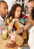 Two Couples Dining Out. Two couples at a cafe drinking frozen beverages. Vertical shot Royalty Free Stock Image