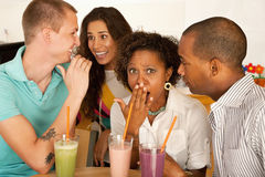 Two Couples Dining Out. Two couples at a cafe drinking frozen beverages. Horizontal shot Royalty Free Stock Photography