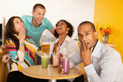 Two Couples Dining Out. Two couples at a cafe drinking frozen beverages. Horizontal shot Stock Image