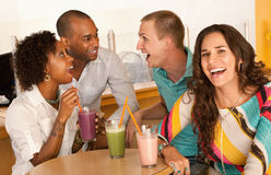Two Couples Dining Out. Two couples at a cafe drinking frozen beverages. Horizontal shot Royalty Free Stock Image