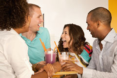 Two Couples Dining Out. Two couples at a cafe drinking frozen beverages. Horizontal shot Stock Photos