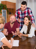 Two couples discussing and smiling Royalty Free Stock Image