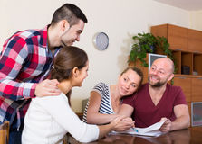 Two couples discussing and smiling Royalty Free Stock Photo