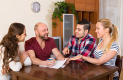 Two couples discussing  and smiling Stock Photos