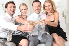 Two couples drinking champagne Royalty Free Stock Photos
