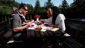 Two couples eating cold cuts for dinner on a beautiful summer day stock video