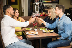 Two couples eating out together Stock Photo