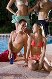 Two couples hanging out in swimming pool Stock Photography
