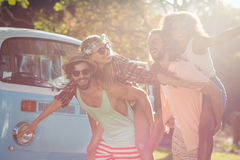 Two couples having piggy ride in park Stock Photography