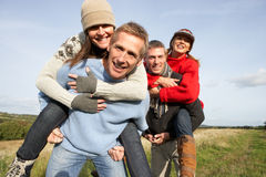 Two Couples Having Piggyback Ride Stock Photos