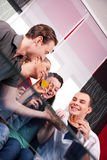 Two couples having a pleasant time at home Royalty Free Stock Photos