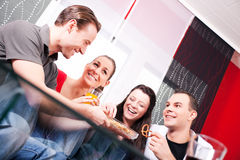 Two couples having a pleasant time at home Royalty Free Stock Images