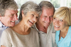 Two couples indoors smiling stock photo