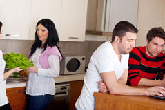 Two couples in kitchen Stock Photography