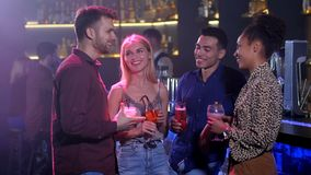 Two couples in love dating in bar clinking glasses