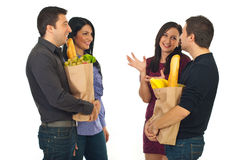 Two couples meeting at shopping for food Royalty Free Stock Photography