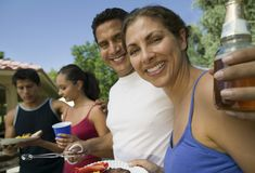 Two couples at outdoor picnic. Stock Photo
