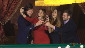 Two couples at the party take a selfie with glasses stock video footage