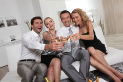 Two couples partying Royalty Free Stock Images