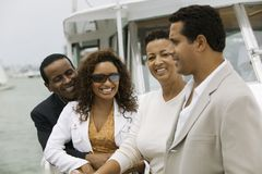 Two couples relaxing on yacht Stock Photos