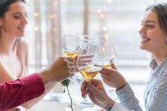 Two couples toasting at the celebration in the restaurant. While concluding business deal stock photos