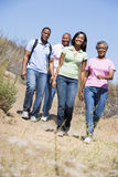 Two couples walking on path smiling Stock Image