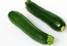 Two courgettes against a white background Royalty Free Stock Images