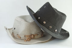 Two cowboy hats. Beige and black cowboy hats on white background Royalty Free Stock Photo