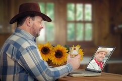 Two cowboys drink whiskey online royalty free stock photography