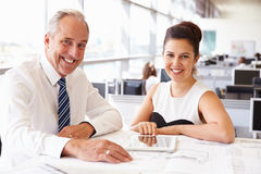 Two coworkers in an architect?s office, smiling to camera Stock Image