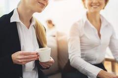 Two coworkers having coffee break Royalty Free Stock Images