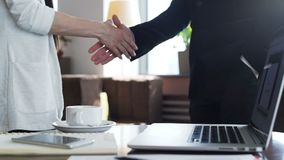 Two coworkers shake hands after negotiation skills. Close up. Male and female successful person signed a contract between companies and congratulation deals stock video footage